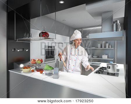 Junge Frau mit Köche Uniform und Haube in einer modernen industriellen Küche