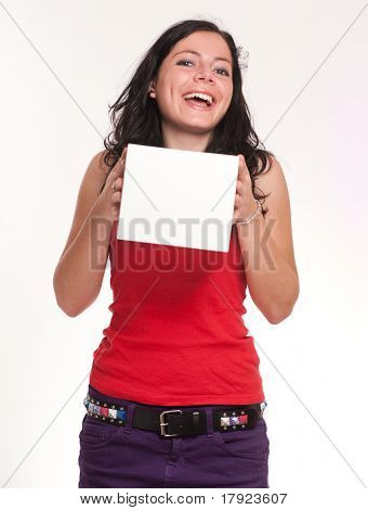 Young brunette holding a white box ideal for inserting your logo or message