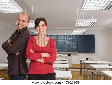 A man and a woman cheerfully smiling on a classroom