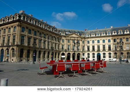 Meeting table and chairs in the middle of the Place Vendome, Paris, France.