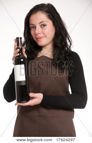 Female with apron presenting a wine bottle with a blank label