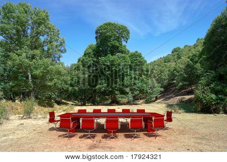 Meeting table and chairs in middle of the countryside