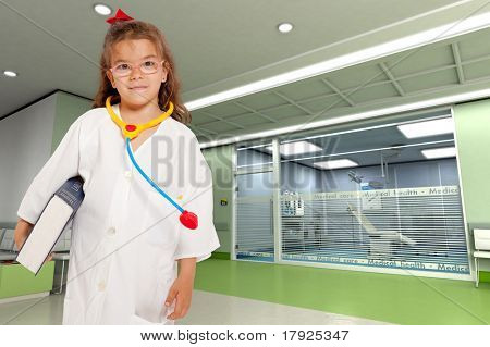 Young girl with a doctor?s uniform and toy stethoscope holding a book in a hospital interior