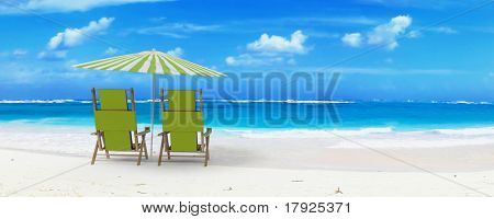 Beautiful beach with sunshade and a pair of reclining chairs with drinks