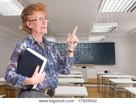 Portrait of a smiling mature teacher in the middle of an explanation