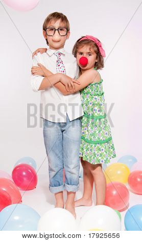 Little boy and girl with fake noses in a balloon party