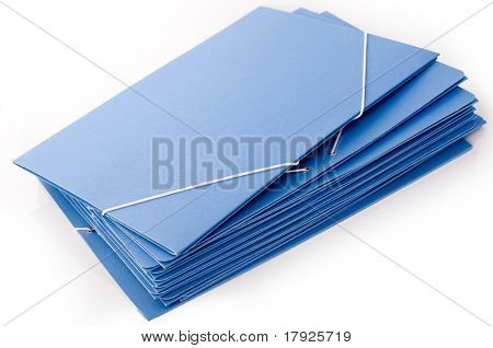 A pile of cardboard blue folders with elastic bands