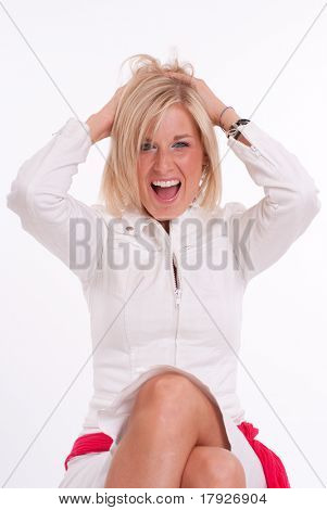 Portrait of an attractive blonde girl laughing