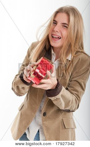 Young teenage girl happily holding a heart shaped box