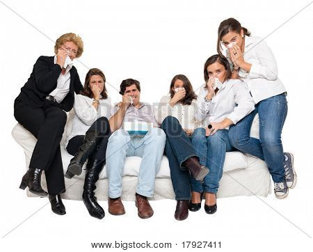 A group of family members sitting at home crying watching tv
