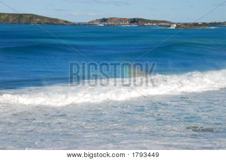 Rolling Waves With View Of Headland &  Marina