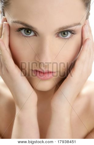 Beautiful woman portrait with hands on head isolated on white at studio