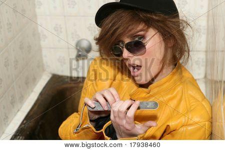 Funny eighties woman leather yellow jacket metaphor on the bath