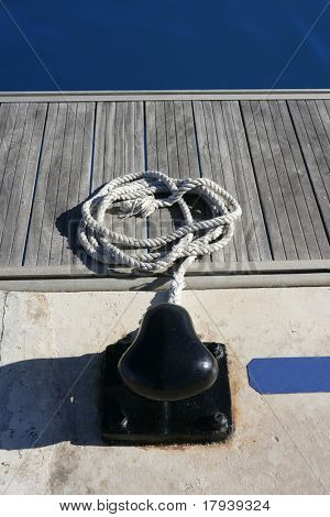 Marina nautical mooring with thread and blue water on background