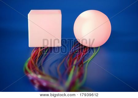 Glowing sphere and square with colorful wires, wired communication metaphor