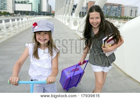 Little girls going to school with bags, books and student stuff