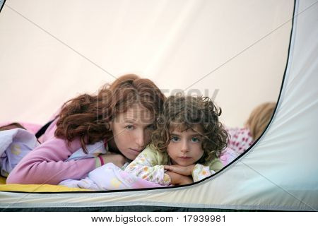 Camping tent vacation with mother and two little daughters