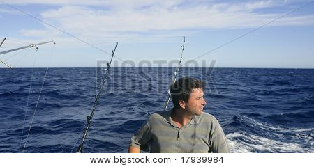 Angler big game saltwater fisher boat with rods and reels