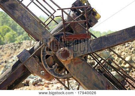 Excavator bulldozer arm wheel rusted detail with steel cables