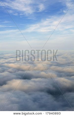 Blue sky view from aircraft airplane and white clouds