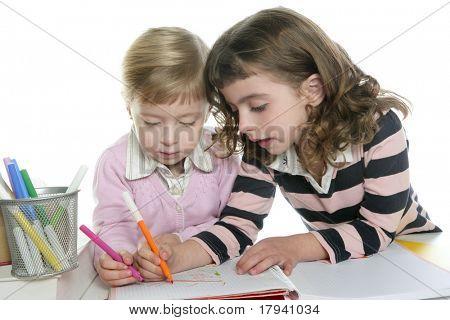 two little sister student doing homework together on table desk teamwork