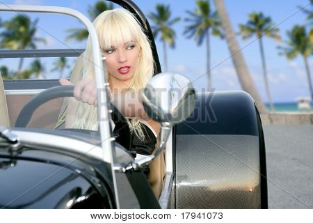 blond beautiful black sport car young sexy girl tropical palm tree beach