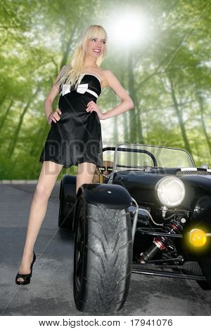 blond beautiful black sport car young sexy girl stand up on forest