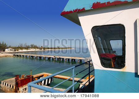 boat ferry control cabin with caribbean sea on background