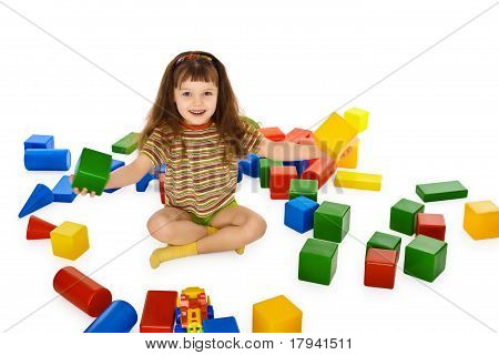 Little Girl Playing With Color Cubes