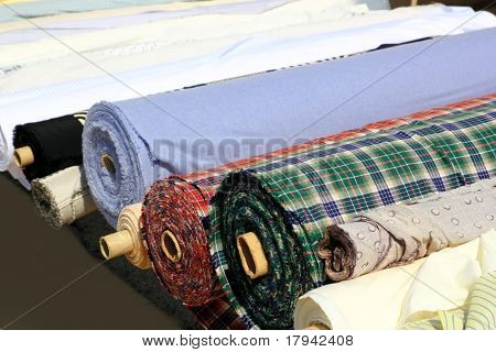 Colorful fabric rolls row in market shop vanishing perspective