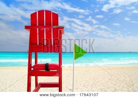 Baywatch red beach seat green wind flag in tropical caribbean sea