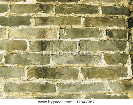 weathered grey brick wall