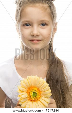 beautiful smiling girl with yellow flower