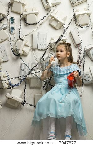 little pretty girl with phones