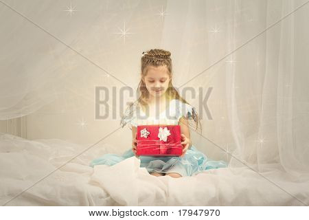 Little girl with a shining box