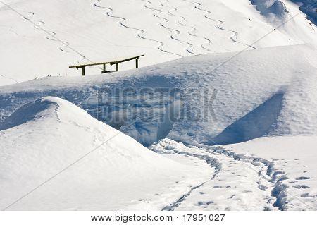 Snowboard Tracks In Alps Snowscape