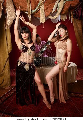 Beautiful Belly Dancers With Indian Man Playing A Sitar