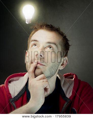 Idea Bulb above young man's head