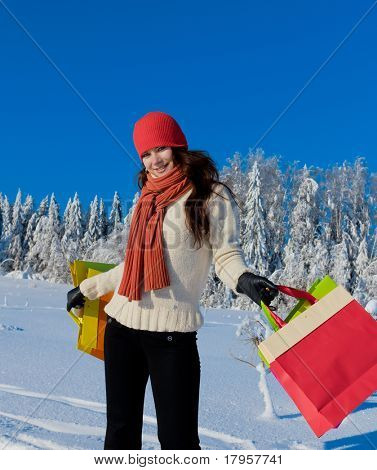 Pretty Shopping Girl at a Wintry Scene
