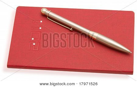 Red Notebook And A Pen