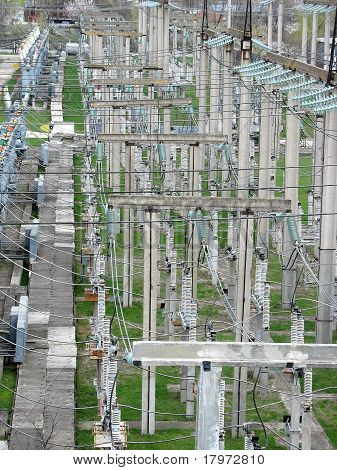 High Voltage Transmission Power Lines At Power Plant