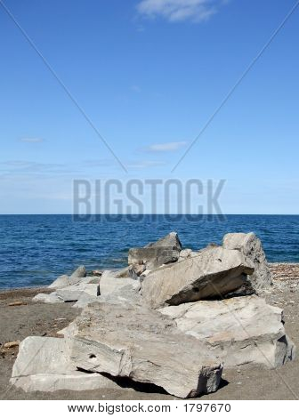 Large Rocks On A Quiet Beach