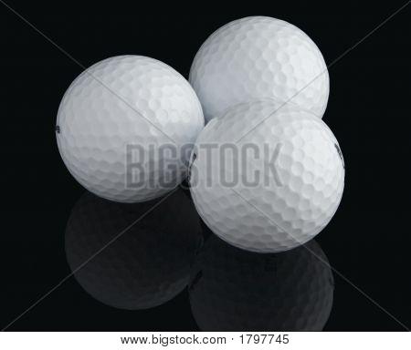 Three Golf Balls