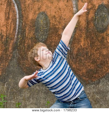 Boy With Painted Wall At Background