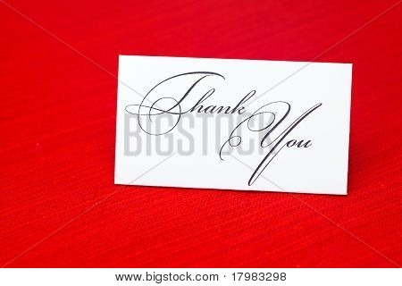 Card Signed  Thank You On A Red Background