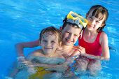 picture of swimming pool family  - happy children having fun with swim in pool - JPG