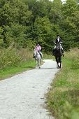 pic of horse riding  - Mother and daughter on a trail ride with pony and horse - JPG