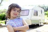 little children girl posing caravan camping vacations summer
