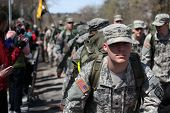 BOSTON - APRIL 18 : Fans cheer on marines marching the marathon in full 40 lb packs during the Bosto