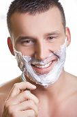 stock photo of young men  - Shaving man with grin smile - JPG